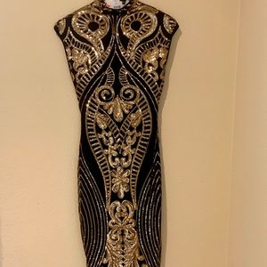 Black and gold sequenced dress